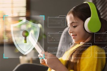 An image featuring a little girl using her tablet with a security logo representing safety image
