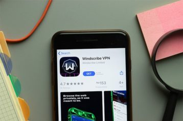 An image featuring a phone that has searched the Windscribe app