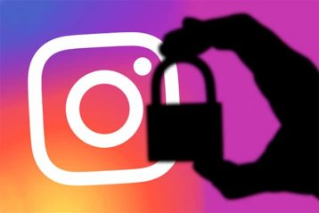 An image featuring a person holding a lock in the shadows with an Instagram logo behind representing a hacked Instagram account concept