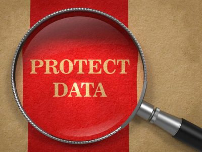 Protect Data through Magnifying Glass on Old Paper with Red Vertical Line.