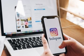 An image featuring a person using Instagram on their phone and laptop