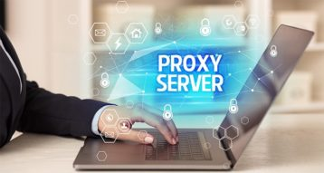 An image featuring a person using his laptop with proxy server text in front representing proxy server concept