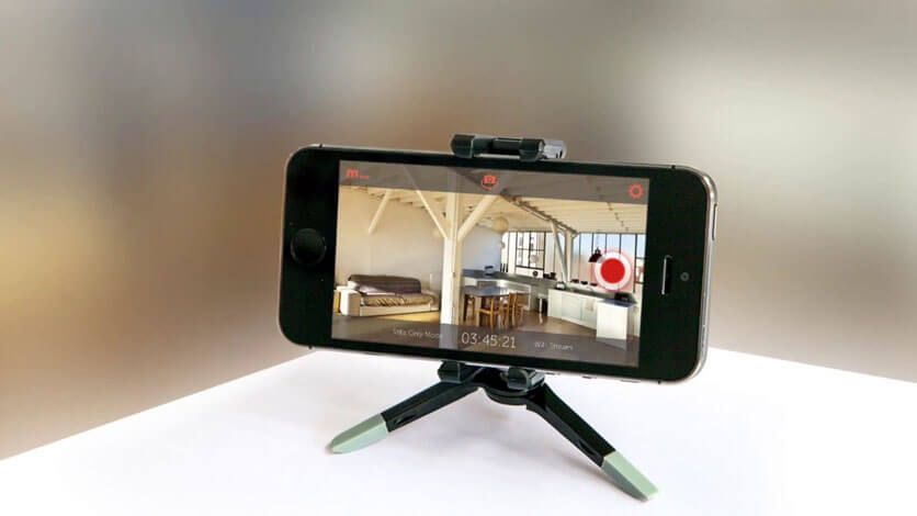 smartphone on a stand showing camera feed.