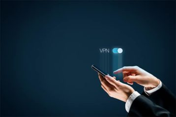 An image featuring a VPN concept with a person using his phone and connecting to a VPN