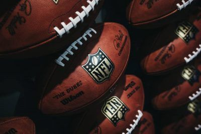 NFL balls stocked one under another.