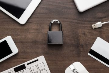 An image of a lock in the center and around it there are multiple devices meaning privacy