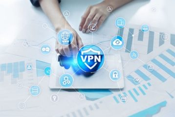 An image of a person using a touchpad with a VPN logo