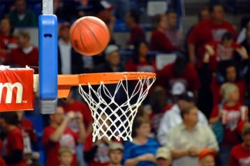 An image featuring a basketball going inside of a hoop