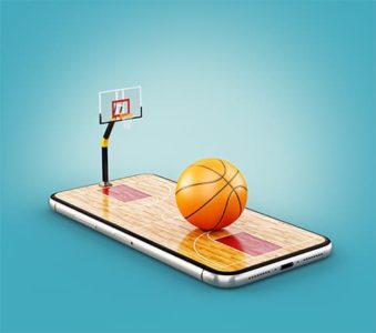 An image featuring a phone that has a basketball hoop and a basketball on top of it