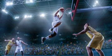 An image featuring a person dunking on a basketball match
