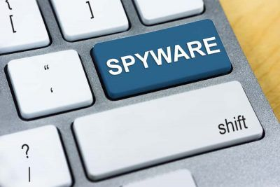 Spyware written on Enter keyboard button.