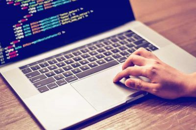 Man coding on laptop.