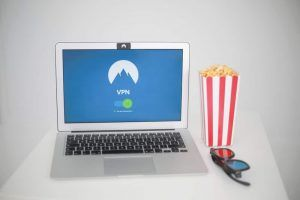 Nord VPN on a background of a laptop with popcorn aside.