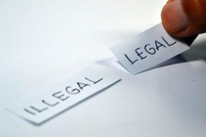 illegal and legal written on two separate pieces of paper