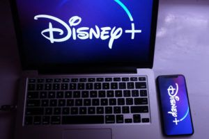Disney+ on laptop and phone