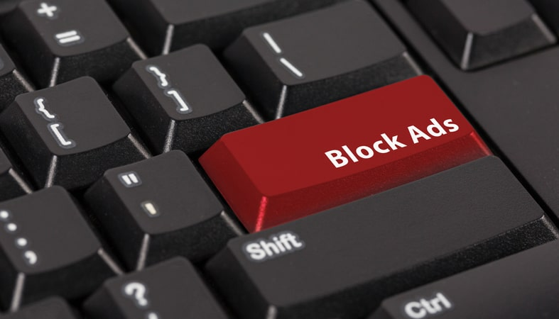 an image of a black keyboard with a red enter key with the words block ads on it