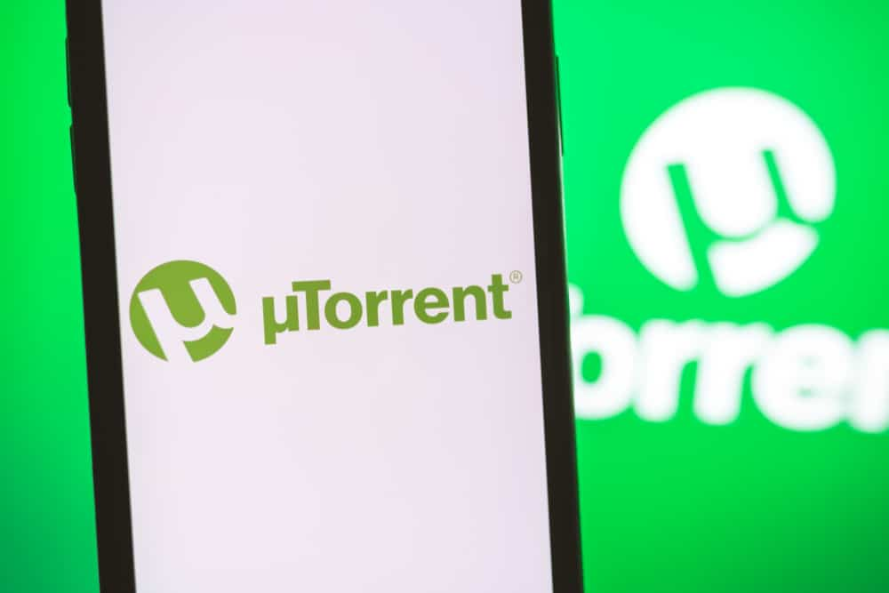 how to turn off utorrent seeding cover image laptop and person planting a seed