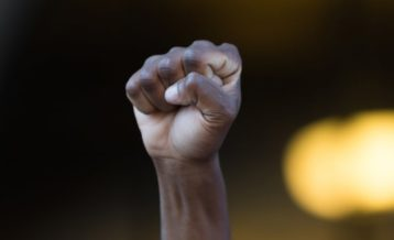 An African-American hand in the form of a fist inspiring strength and leadership