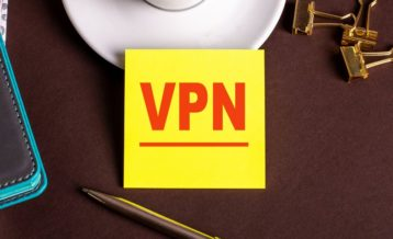 an image with pens in the background as well as clippers and a yellow note in the middle which says VPN in red