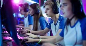 A team of gamers playing competitively
