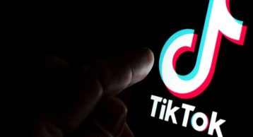 TikTok Man pointing Finger with Black Background