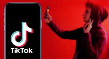 a person dancing behind a phone running TIkTok