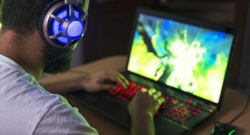 person gaming on a laptop