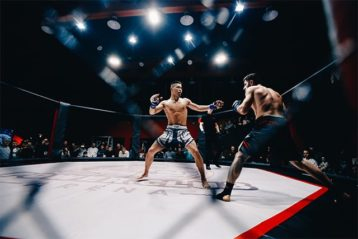 UFC fighters fightingn in a ring