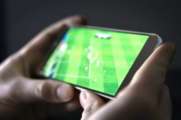 a person stremaing football on their mobile device