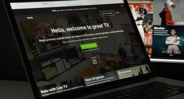 an image of a laptop which has hulu running in the background