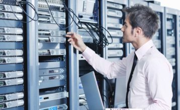 an image of a person managing a server room