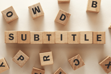 Subtitle text on wooden cubes