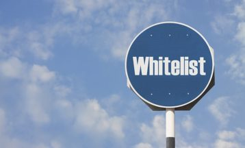 a blue sign with the word whitelist on it