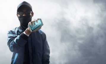 a person holding a phone facing towards the camera indicating that it has been hacked or used for hacking