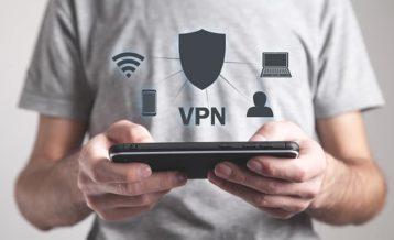 a person using a phone with a vpn to browse safely online