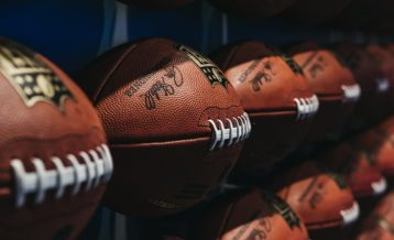 an image of a bunch of footballs on a rack