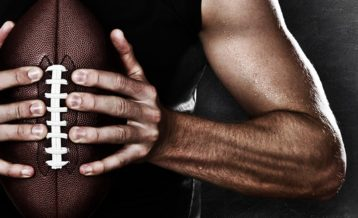 an image of a football NFL player holding his football