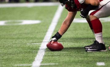 an image of a football player preparing to hit the ball