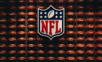 an image of the nfl logo with footballs in the background