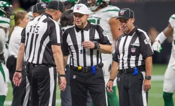 an image of three NFL referees