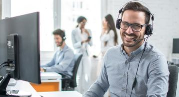 an image of a person working in technical support