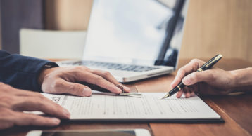 an image of a person analyzing a legal contract