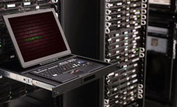 A laptop within a server room delivering a DDoS attack