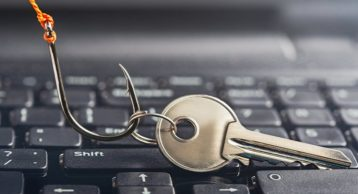 an image of a key sitting on top of a laptop