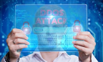 DDoS attack person using a tablet