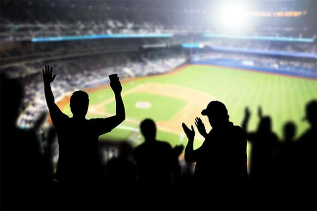 An image featuring people cheering on a stadium representing the major world sporting events 2021