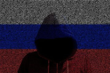 An image featuring a person in a hoodie representing a hacker with the russian flag in the background made in code