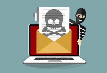 An image featuring a pirate hiding behind a laptop with a message that is printing and that has a pirate sign representing internet piracy