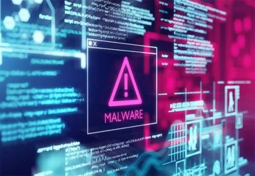 An image featuring a screen with warning signs that says malware in the middle