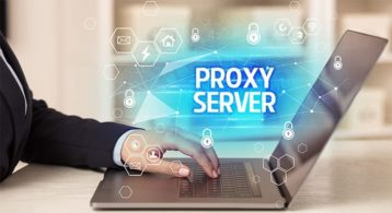 An image featuring a person using his laptop with a text on the background that says proxy server